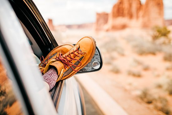 Danner Boots Sticking Out of a Window in the Desert