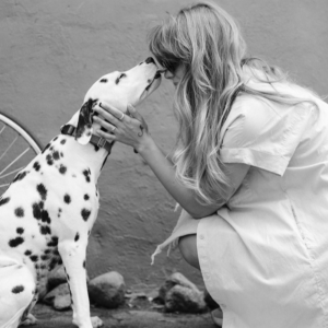A woman with a dog, showing real care in how each other are